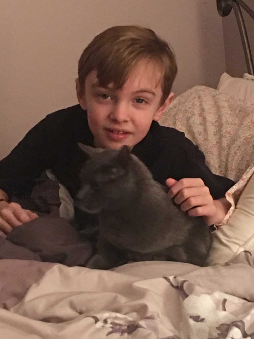 Doctors discovered that Robert Amato, 11, above with his cat, Molly, has an inoperable brain tumor.  As a way to lift his spirits, the Island Park community brought Christmas to him in the hospital.