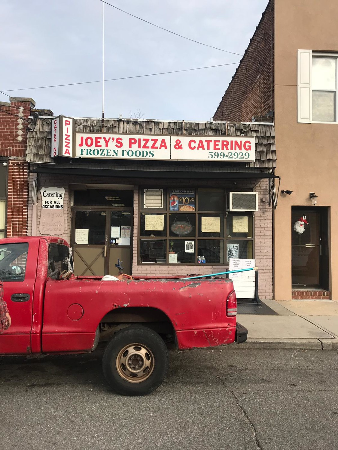 A Hewlett Harbor man is charged with attempted murder after he came into Joey's Pizza armed with a machete and tried to injure an employee and the store's owner, according to police. He is due back in court on Jan. 4.