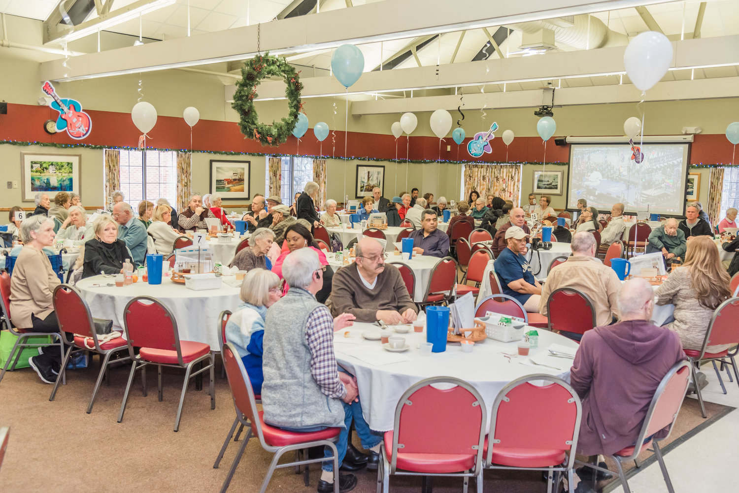 he senior center dining room, right, was packed with excited residents who were eager to ring in the new year with a home cooked meal.