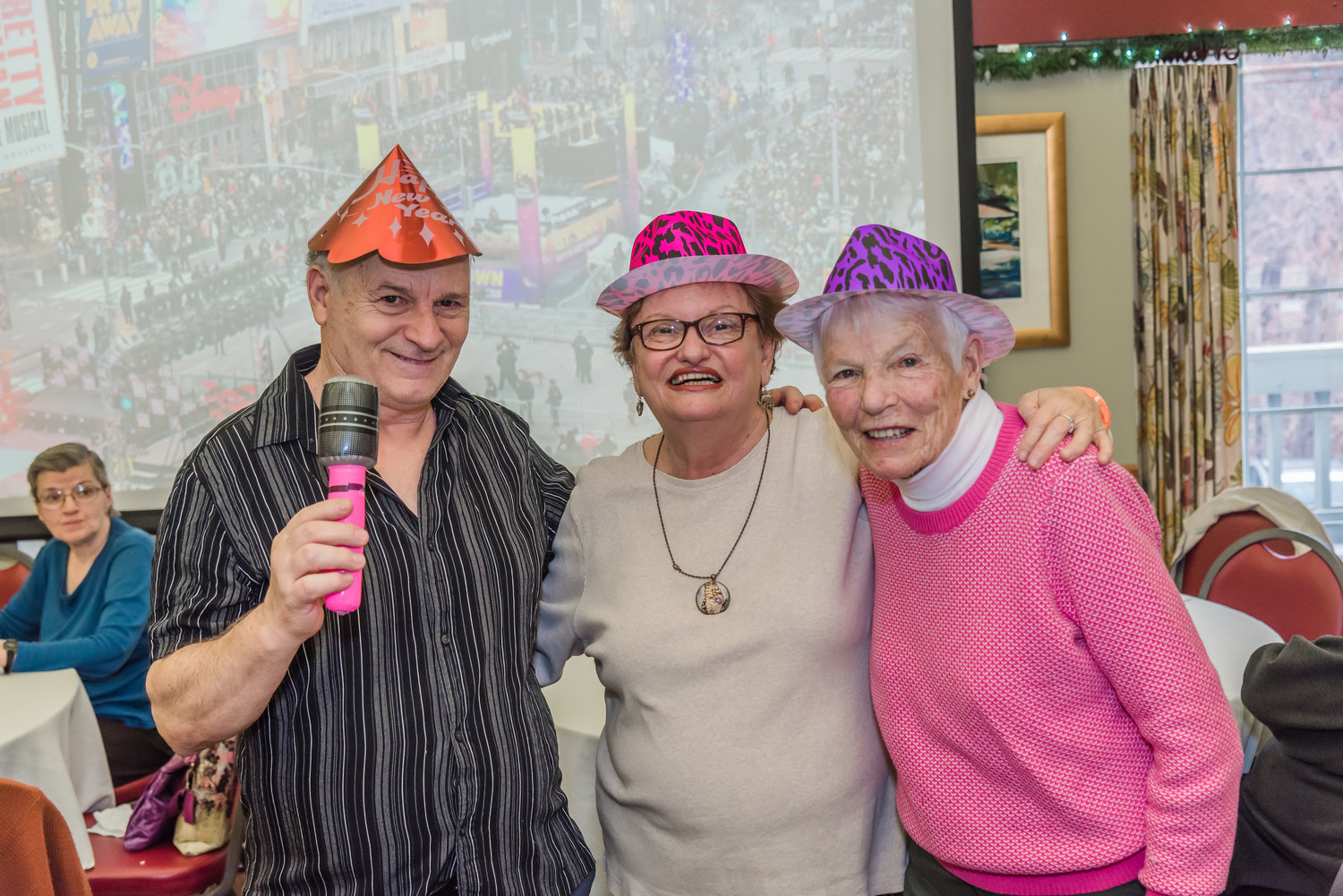 James Simeone, left, Annette Medugno and Pat Parmelee were feeling festive in their decorative New Year's hats.