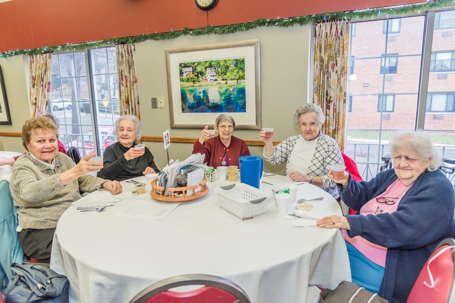 A group of gal pals at the senior center made a toast to their lifelong friendship.