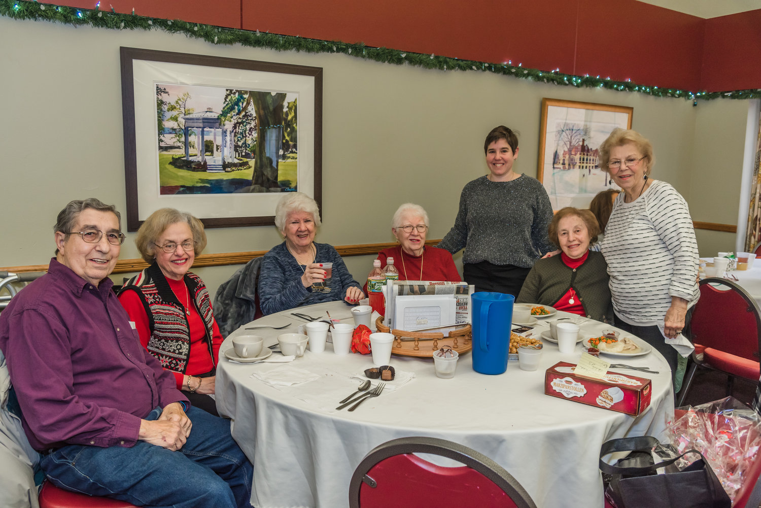Glen Cove City Councilwoman Marsha Silverman, third from right, met with seniors at the luncheon to find out their hopes for the new year.