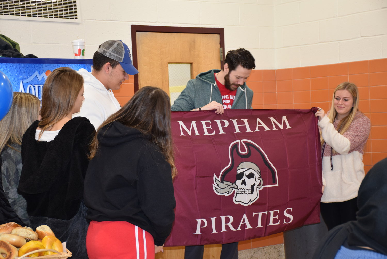 The seniors gave retired U.S. Navy Petty Officer Ryan Shannon a Pirates flag to welcome him to the family.