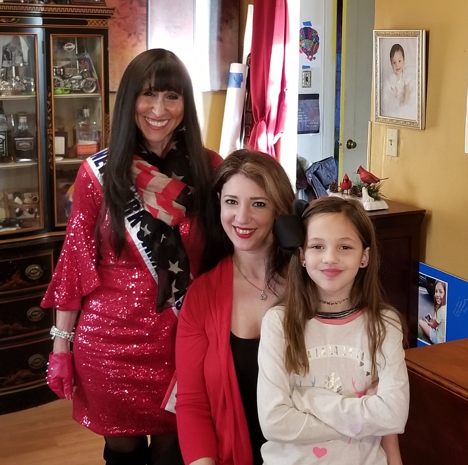 Jane Rubinstein, far left, with Lisa DeStefano and her daughter, Giavanna. Rubinstein worked with other members of Ms. New York Senior America to honor DeStefano, a Marine Corps veteran.