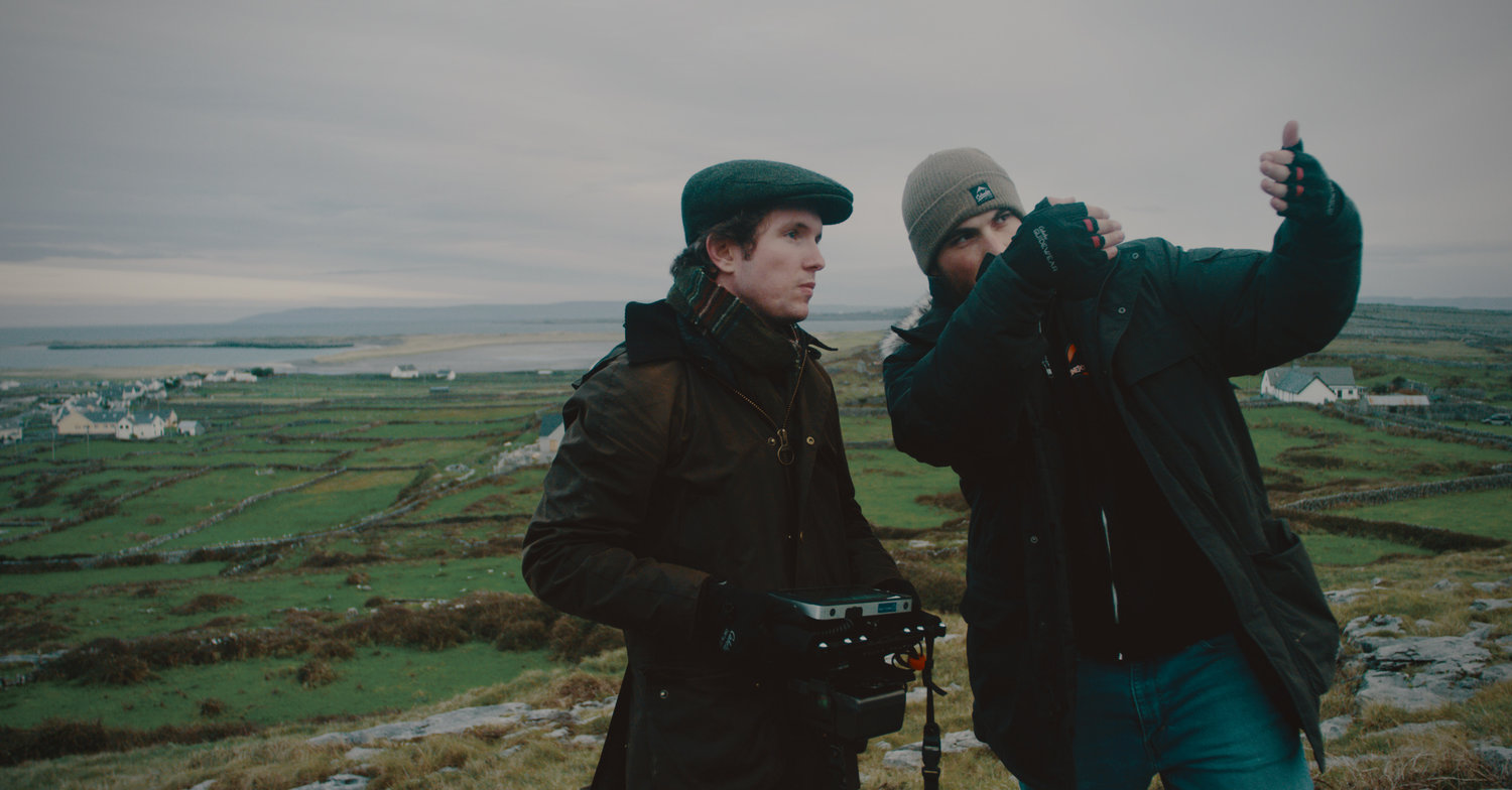 "Writer, director and producer Kevin Quinn, left, a North Shore High School graduate, with cinematographer Tristan Moffatt on location for ""The American Wake"" in Inis Mór, Ireland."