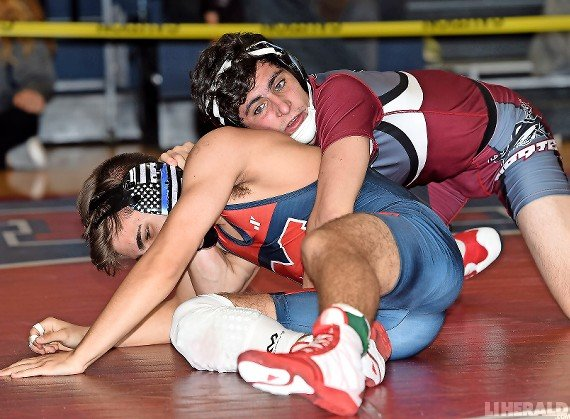Mepham's Jack Molloy, top, finished runner-up in the 132-pound weight class at the MacArthur Tournament.