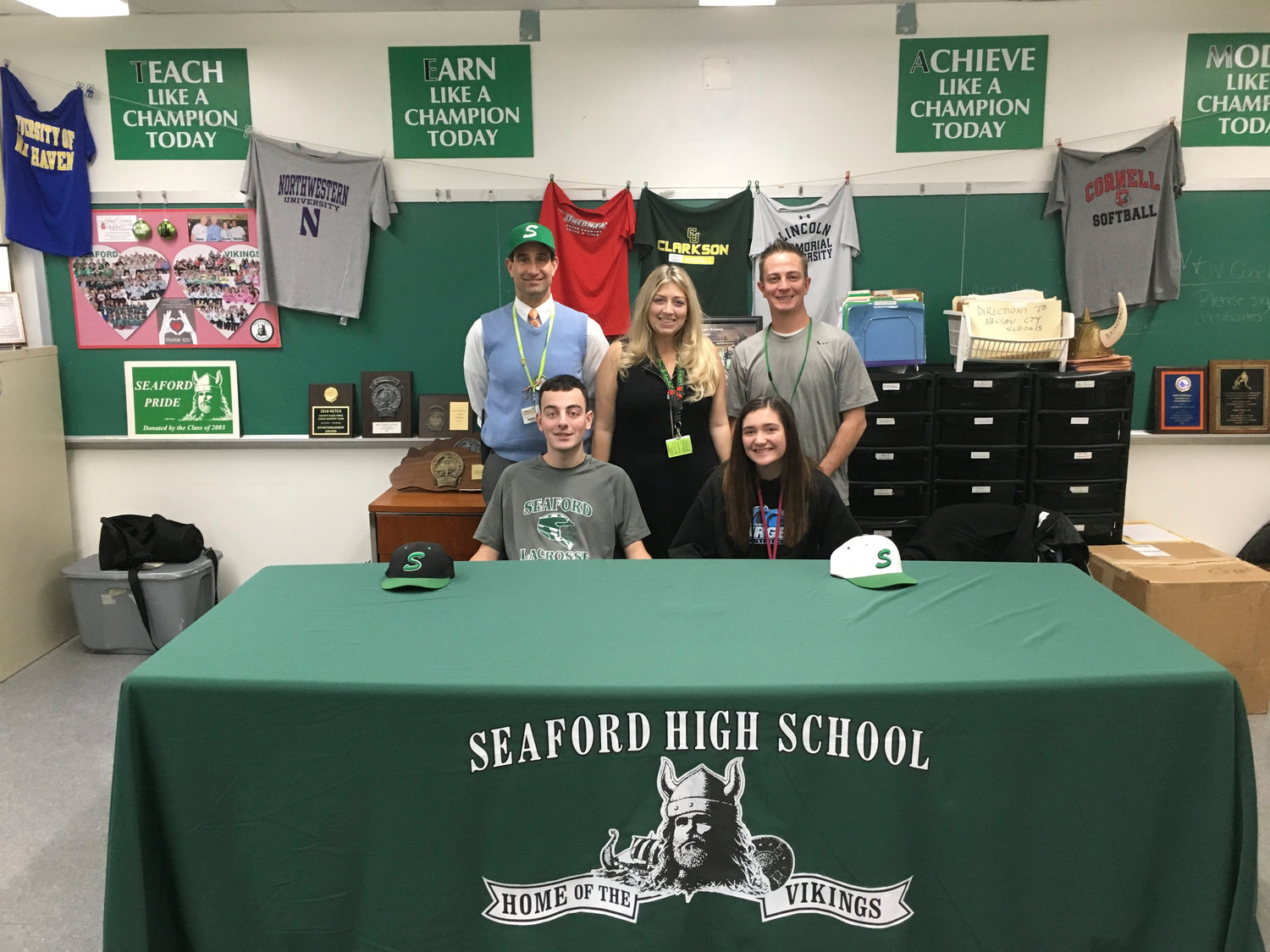 Seaford High School Senior Max Pedone, bottom left, and Junior Paige Donovan, bottom right, are supported by Seaford High School Principal Scott Bersin, left rear; Assistant Principal Nicole Schnabel, center; and Director of Athletics Michael Spreckels.