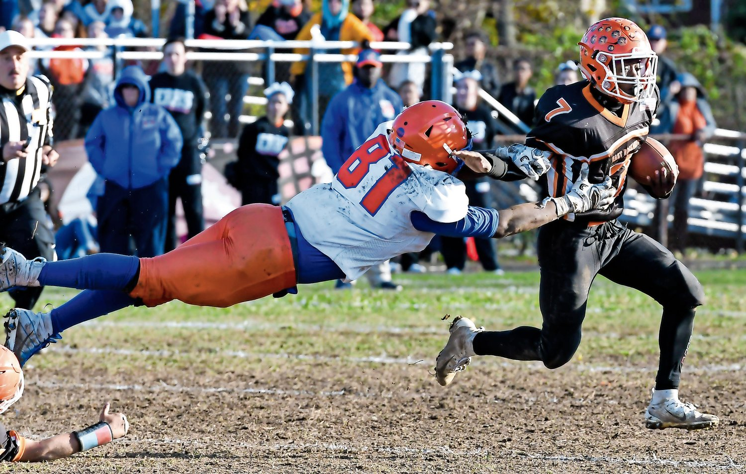 Malverne High School defensive end Jovani Duran, airborne above (on natural grass), won a competition sponsored by the LandTek Group for a video showcasing his pass-rushing skills.
