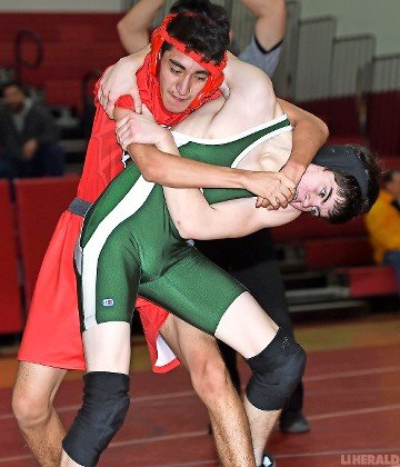 Valley Stream South's Anthony Bravo, left, tangled with Valley Stream North's Evan Burke in the 132-pound bout last Friday night.