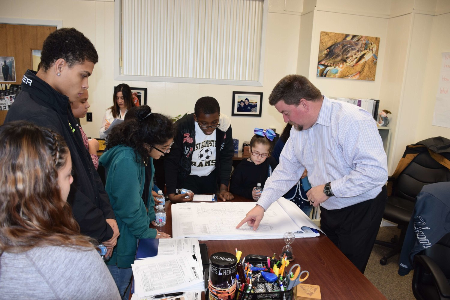 Members of the SSAC got to see diagrams and sketches about potential plans to enhance their school buildings.