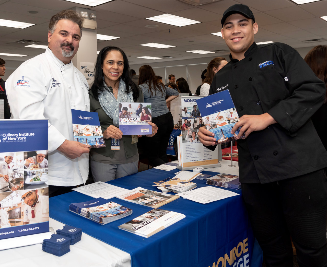 Noel Taverez, right, of the Malverne Union Free School District, got to meet with reps from the Culinary Institute of New York.