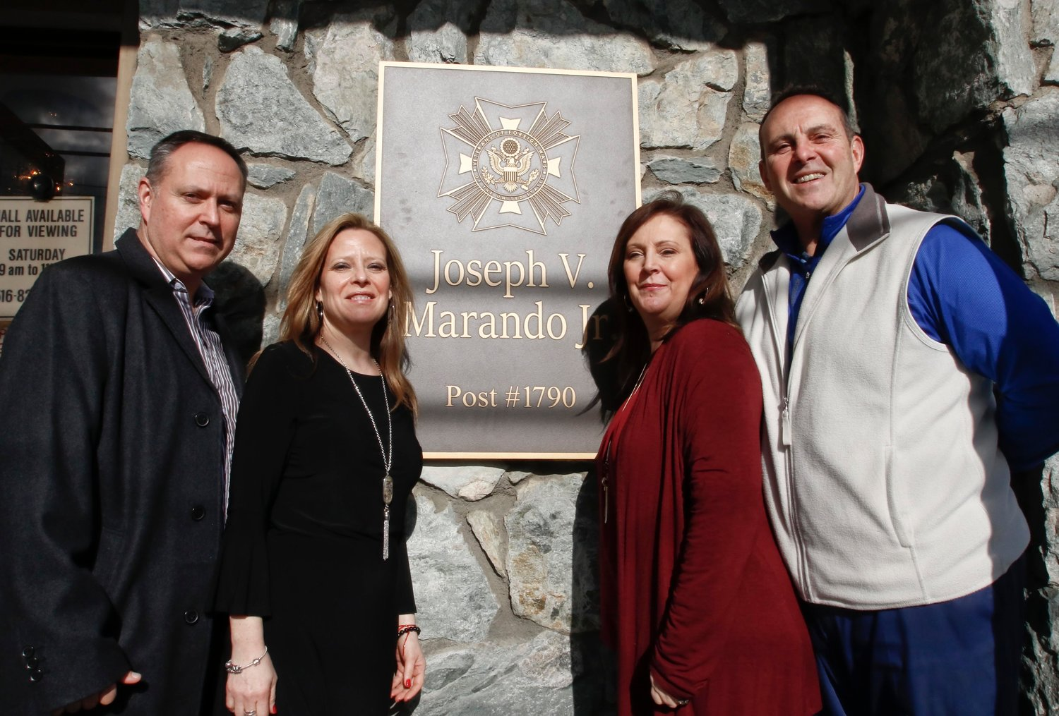 Last Sunday, four of Joseph Marando Jr.'s children — from left, William Marando, Benedetta Ginsberg, Tina Santos and Joseph Marando — unveiled a plaque at the Veterans of Foreign Wars Post No. 1790's building on Merrick Road in memory of the late post commander.