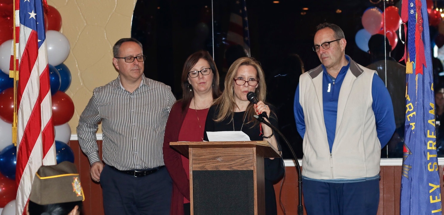 Benedetta Ginsberg, at lectern, with her siblings, from left, William Marando, Tina Santos and Joseph Marando, spoke of how much her father loved the VFW.