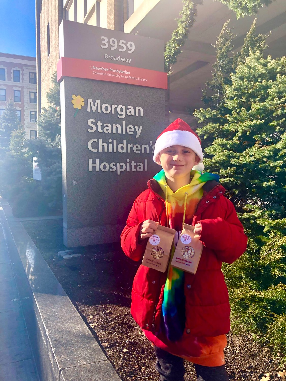 Aidan Pearsall showed off some of the toys that Mended Little Hearts of Long Island donated to the Morgan Stanley Children's Hospital last month.