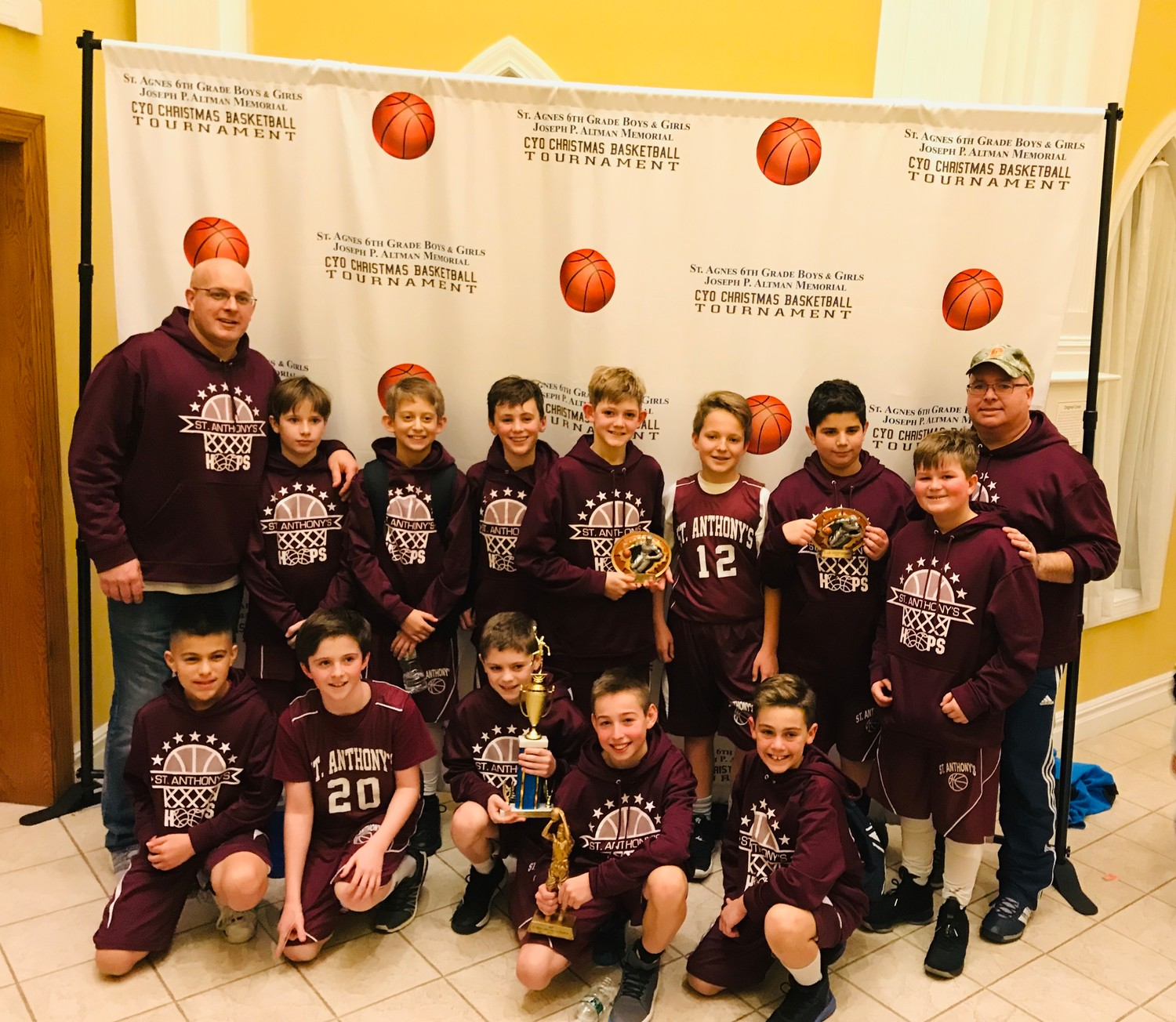Under the direction of coach Frank Wassenbergh, back left, and assistant coach John Hunt, back right, the Oceanside CYO basketball team won the annual St. Agnes Christmas tournament last month. Above, from back row left, Sean Hunt, Justin Beckerman, Keaton Levine, Dylan Wassenbergh Jack Luttrell, Matt Monfiletto and Will Purrman along with, from front row left, Robert Wallace, Declan Costello, Matt Laudicina, Owen Joyce and Luca Nagrowski after the victory.