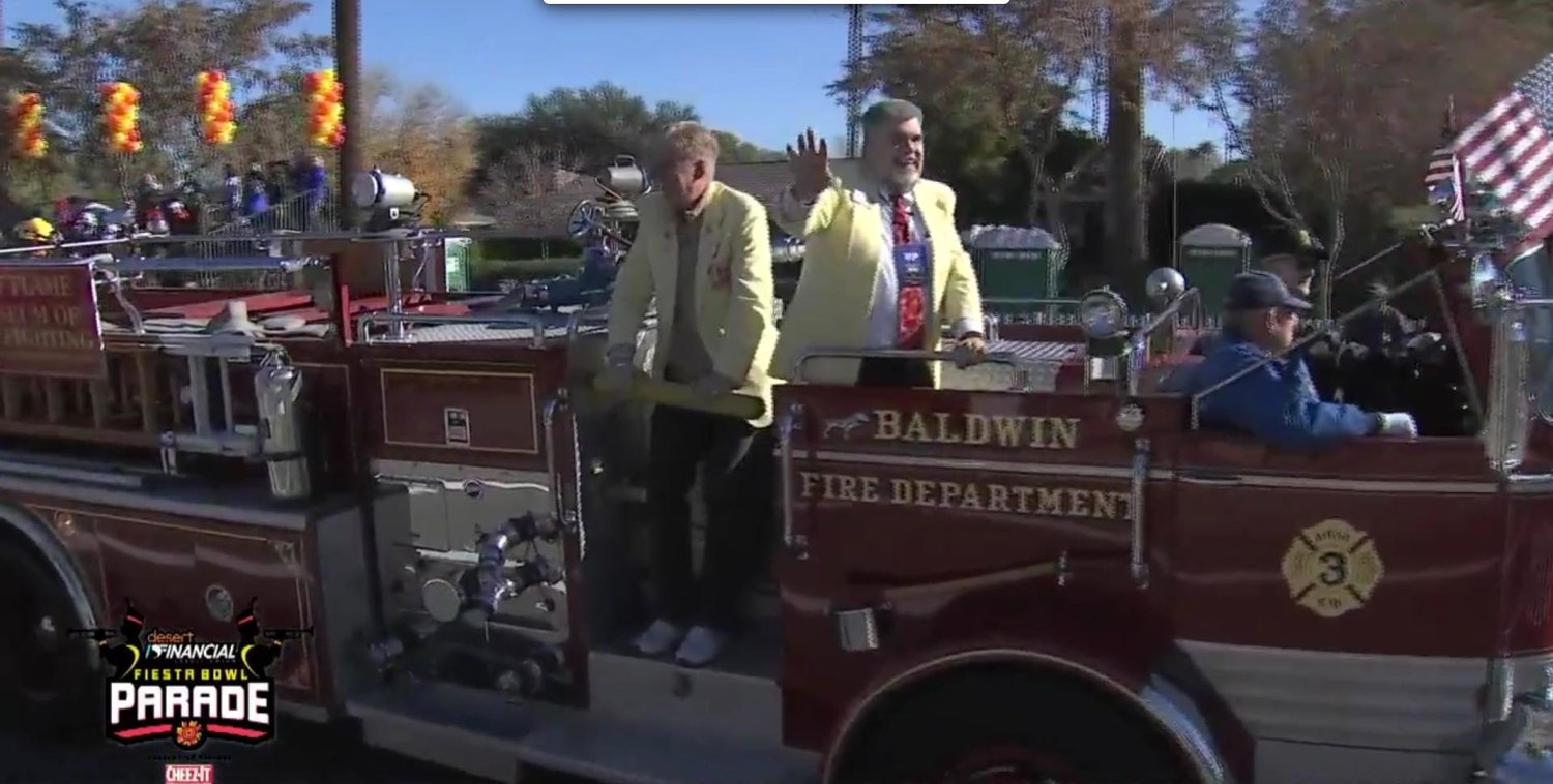 Members of the Hall of Flame firefighting museum rode on the 1966 Mack fire truck previously used by the Baldwin Fire Department.