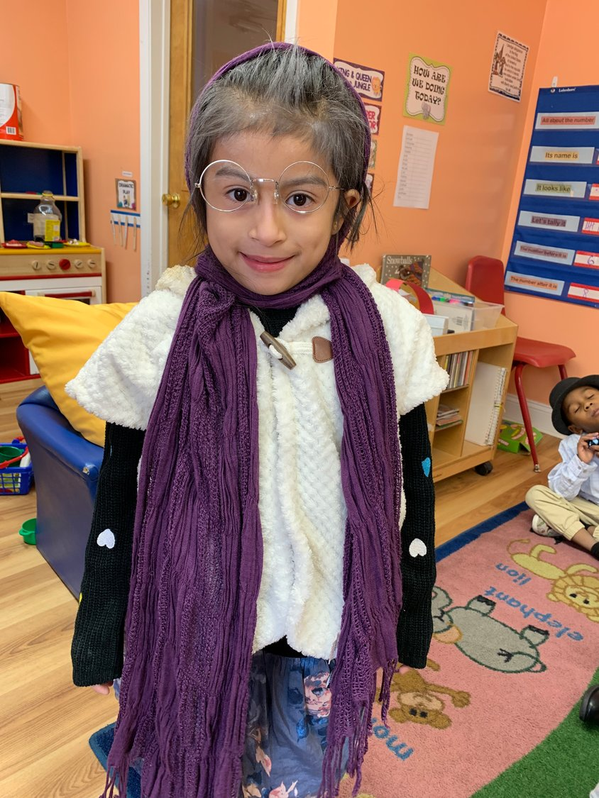 Fatima Perez, 5, borrowed some clothing to dress up as a grandmother.