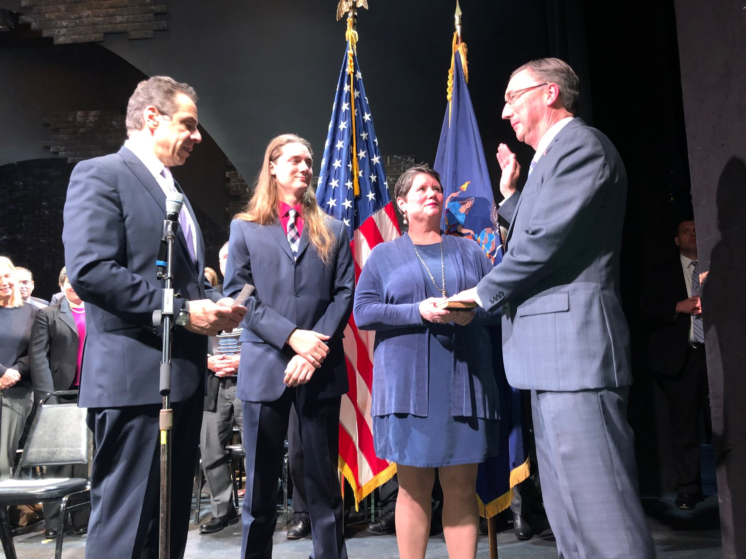 Jim Gaughran, right, with his wife, Carol, and son, Michael, was sworn in by Gov. Andrew Cuomo at the Engeman Theater in Northport, becoming the state senator for the 5th District.