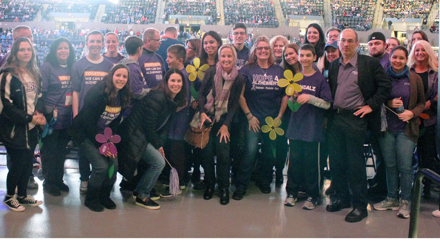 A group of people in purple — supporting the Long Island chapter of the Alzheimer's Association — stood out in a sea of blue and orange at the New York Islanders' game at Nassau Coliseum on Jan. 3, which was designated Alzheimer's Awareness Night at the arena.