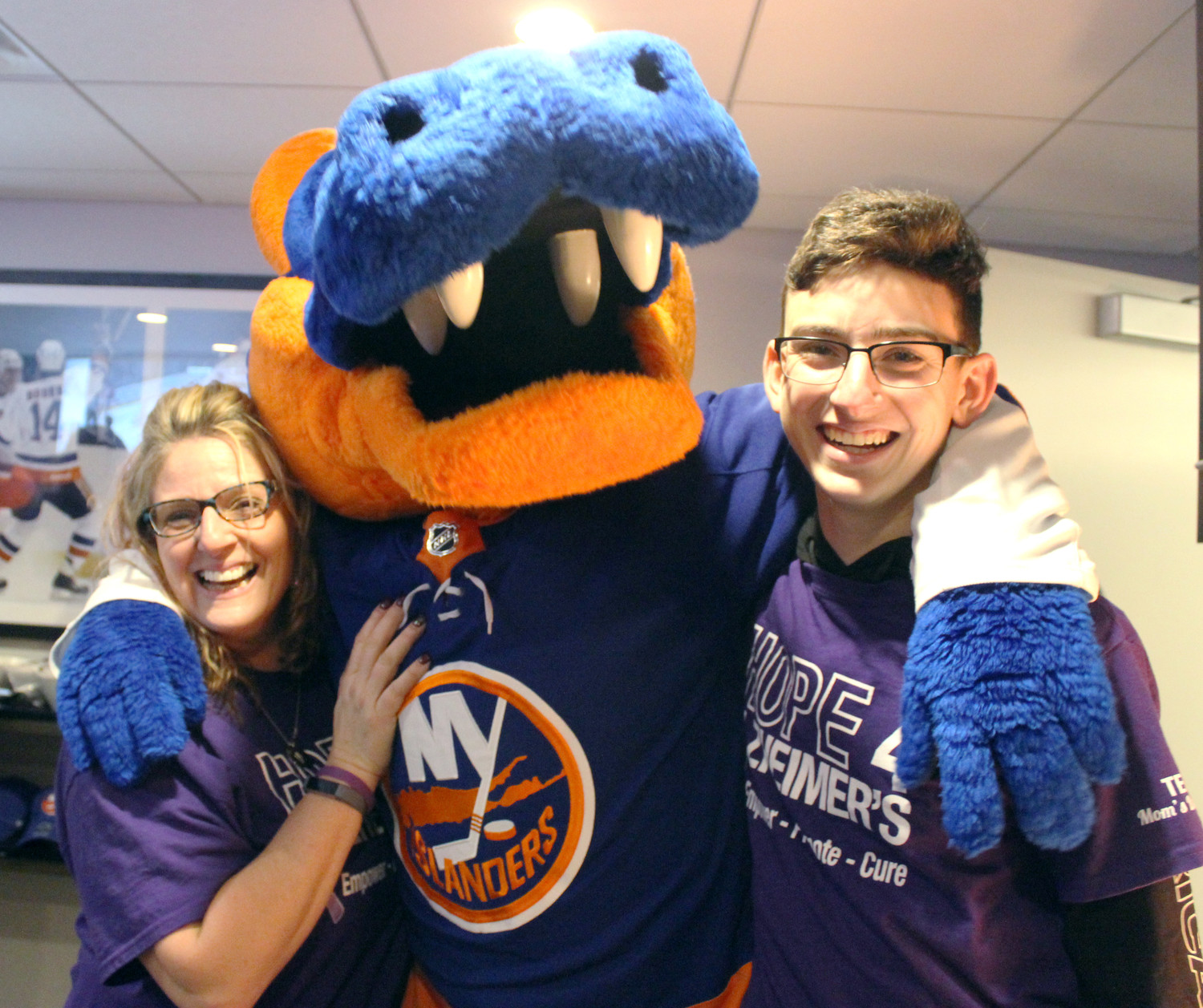 Judy Gronin, 52, of Shirley, and her son Dale, 16, made friends with Sparky, the Islanders mascot, when the hockey team joined the Long Island chapter of the Alzheimer's Association for Alzheimer's Awareness Night on Jan. 3 at Nassau Coliseum.