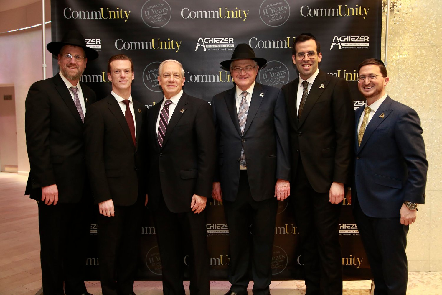 Rabbi Yossy Ungar, left, Dr. Ari Hoschander, Dr. Martin Kessler, Ronald Lowenger, Rabbi Boruch Bender and Shalom Jaroslawicz at the Achiezer gala in Atlantic Beach on Jan. 6.