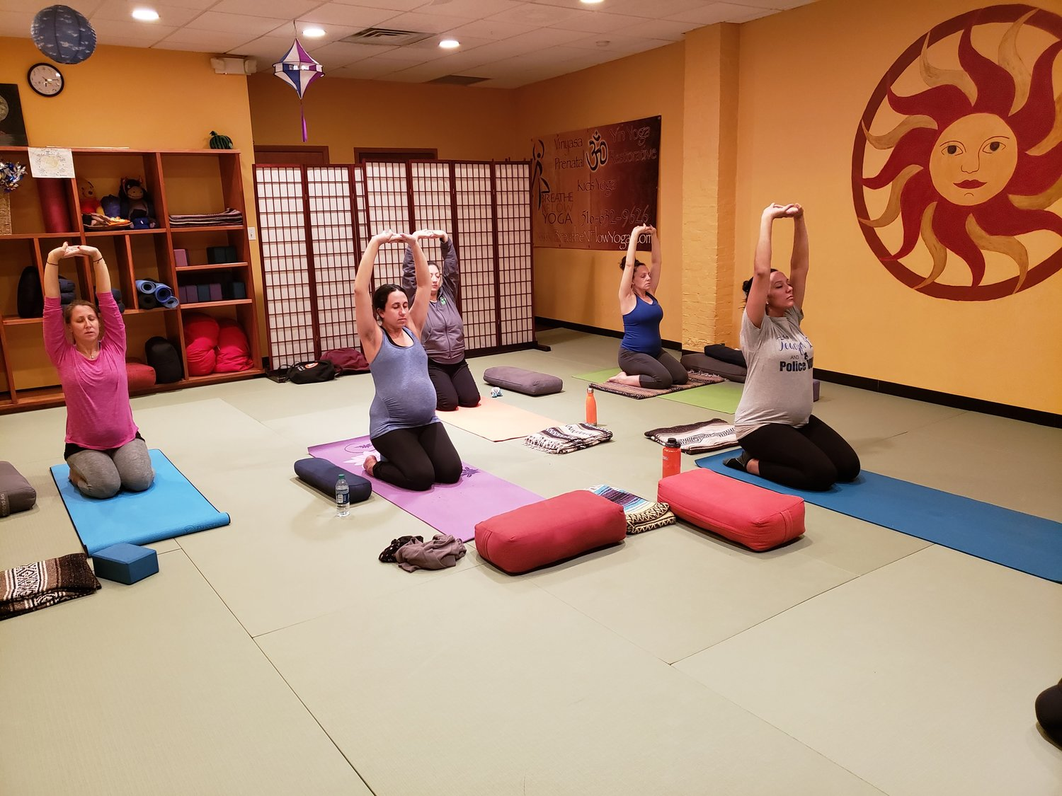 Breathe N Flow prenatal yoga students stretched into a variation of the virasana pose during their weekly class on Jan. 8 in Freeport.