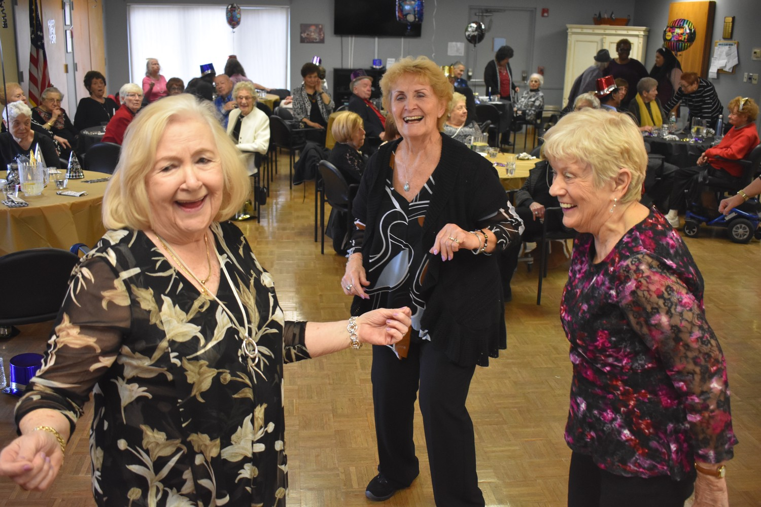 Helen Gemnell, left, Marge DePhillips and Pat Turner danced the afternoon away at the Sandel Senior Center's New Year's party on Jan. 4.
