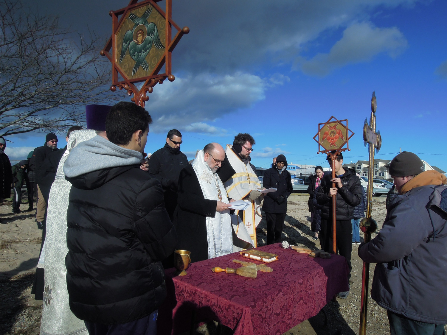 His Eminence Archbishop Michael Dahulich, center, of the Orthodox Church in America's Diocese of New York and New Jersey officiated at Seaford's Great South Bay on Jan. 6. He was assisted by Rev. Martin Kraus, right, of Holy Trinity Orthodox Church in East Meadow.