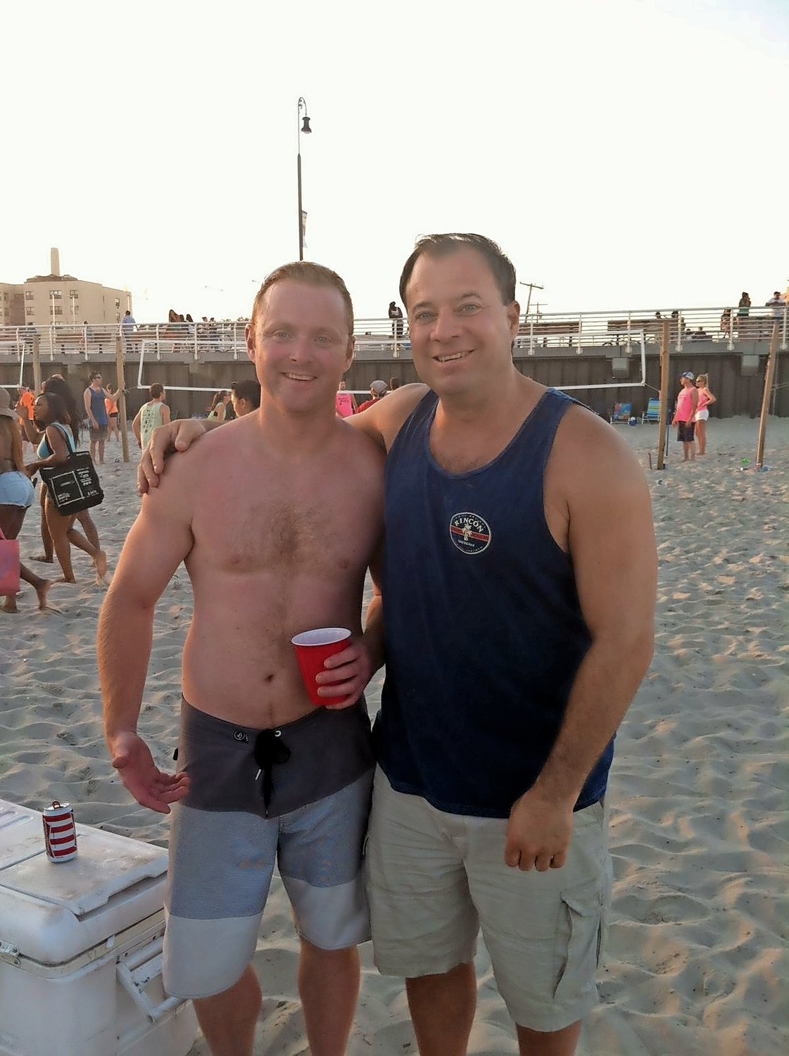 Moschella, right, with friend Jimmy Kennedy during beach volleyball in 2015.