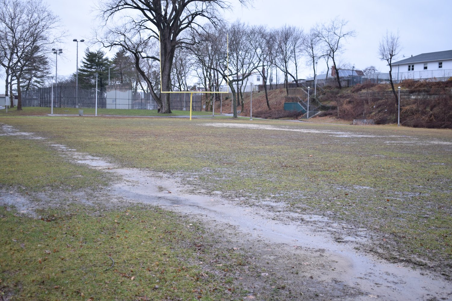 The field in Elmont Road Park has been left torn up by years of use and mismanagement. The Elmont Cardinals can no longer play on this field.