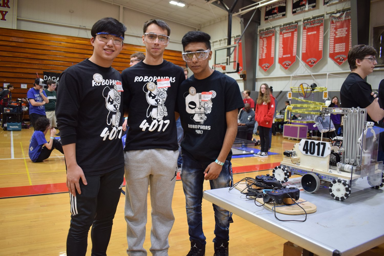 Sewanhaka Robotics Club members, from the left, Gabe Wong, Thomas Van Holten and Parsva Shah led their teams robot through the 2018 FIRST Tech Challenge competition on Jan. 6 at the Long Island Lutheran High School in Glen Head.