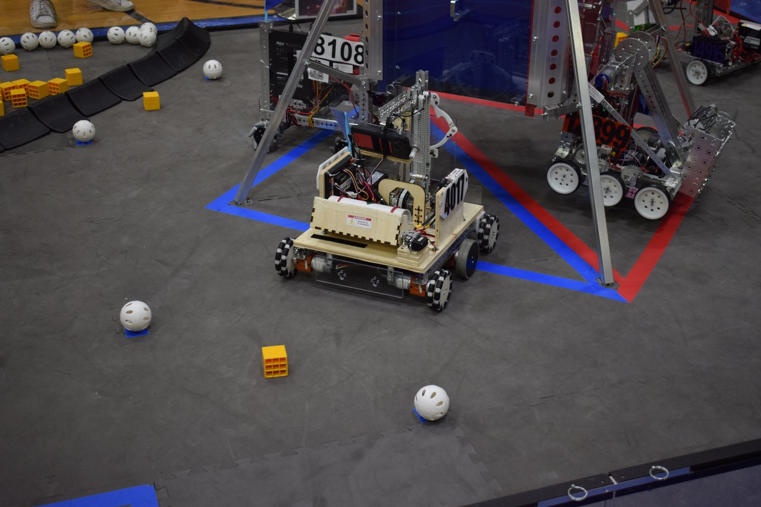 Using its pre-programmed code, the Sewanhaka RoboPandas' robot lowered itself from its lander and began scanning its target during the Autonomous Period of the course.