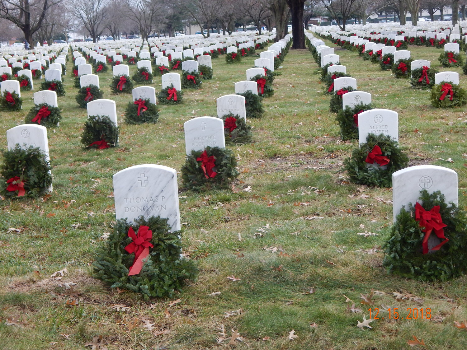 The teens and local volunteers helped place more than 2,000 wreaths at the tombstone of local veterans lying at the Long Island National Cemetery.