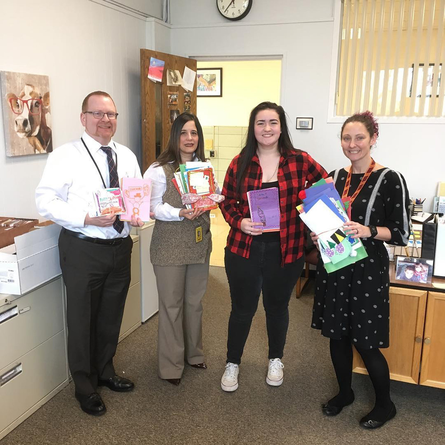 West Hempstead class of 2018 graduate Lauren Faulds, second from right, collected holiday cards made throughout the district on Dec. 14 to deliver personally to Maddox Hyde in Pittsburgh.