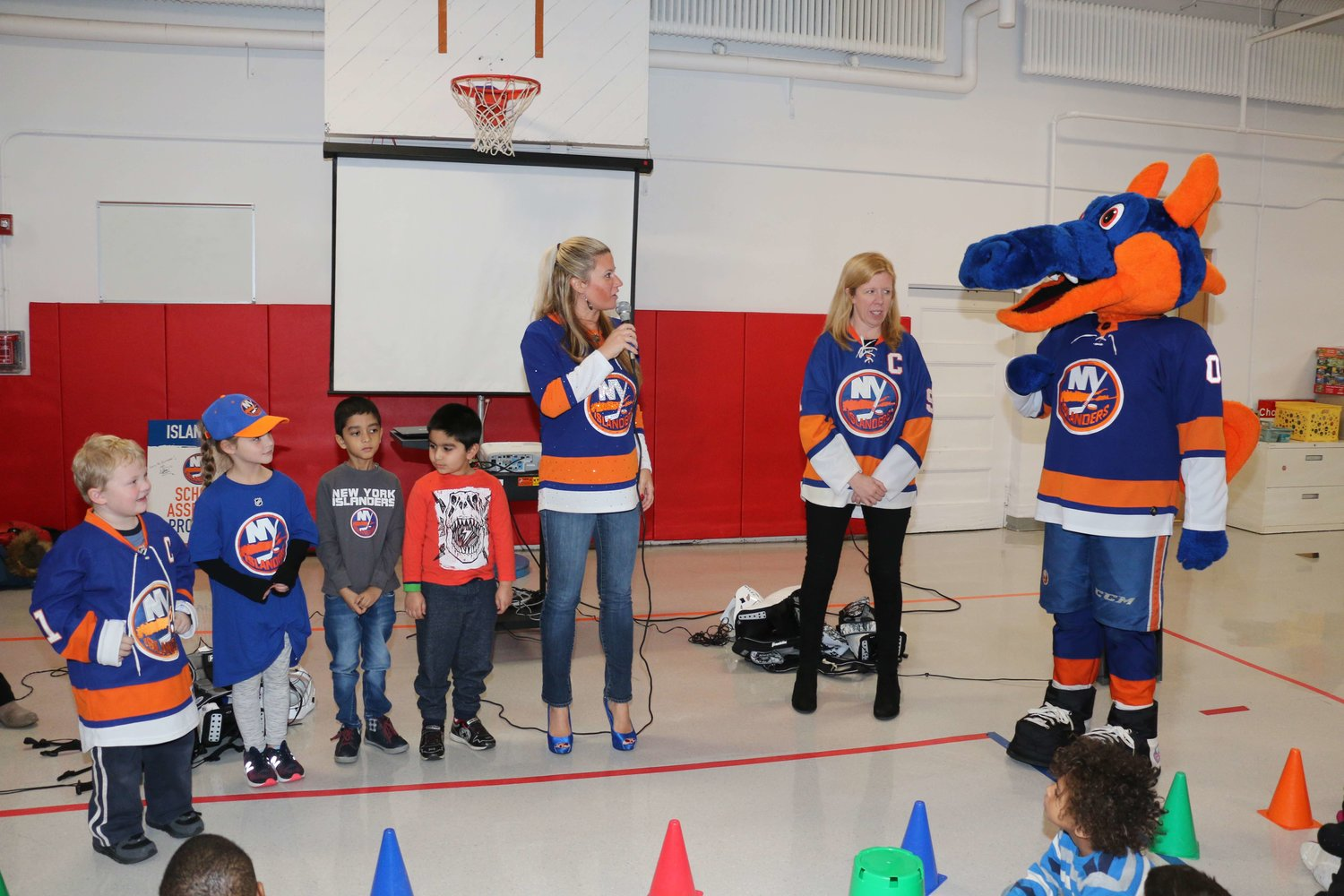 New York Islander's mascot Sparky the Dragon, along with ICE Tour member Dina Tsiorvas, center, made a visit to Chestnut Street School on Jan. 3 for a special assembly on teamwork.