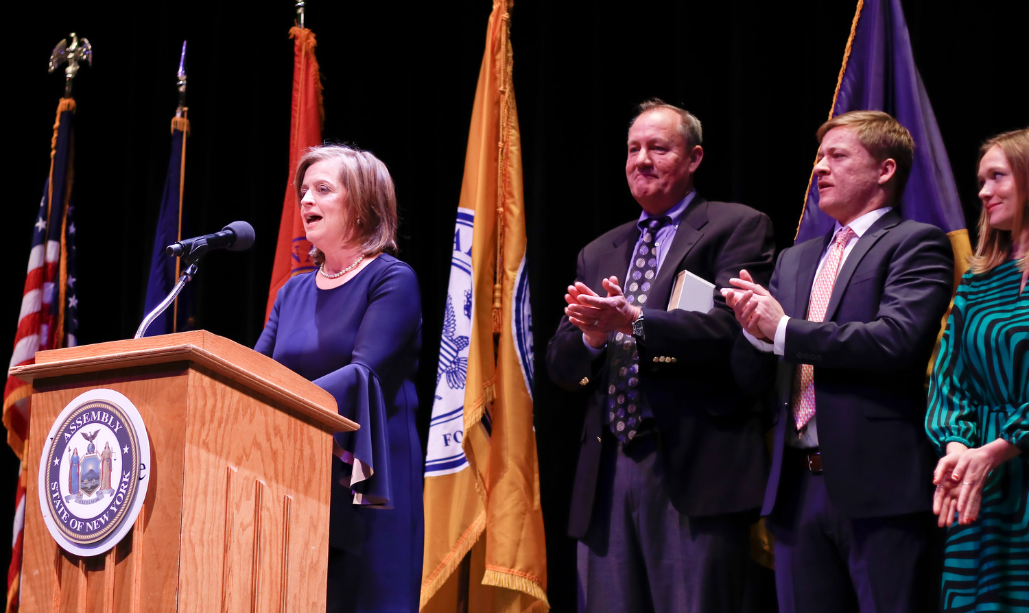 State Assemblywoman Judy Griffin, left, addressed the crowd after being sworn in at Molloy College's Madison Theatre on Jan. 13.