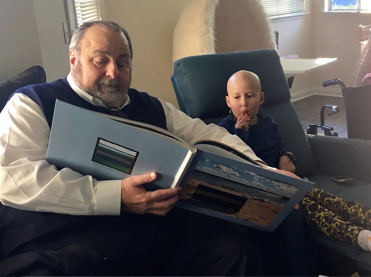 "Rockville Centre Mayor Francis X. Murray read a book called ""#Kimistrong"" to his niece, Kimiko Schroder, 12, last month. She died on Jan. 6."