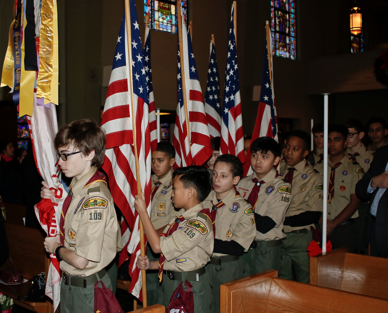 To start the ceremony, the color guard and Troop 109 scouts brought the flags forward and recited the Pledge of Allegiance.