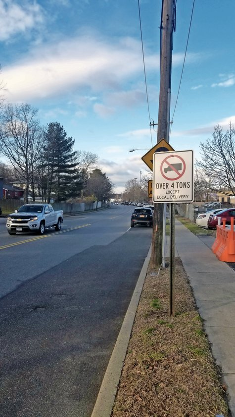 Signs commissioned by the City of Glen Cove indicate that trucks over four tons should not drive on Shore Road unless making local deliveries.