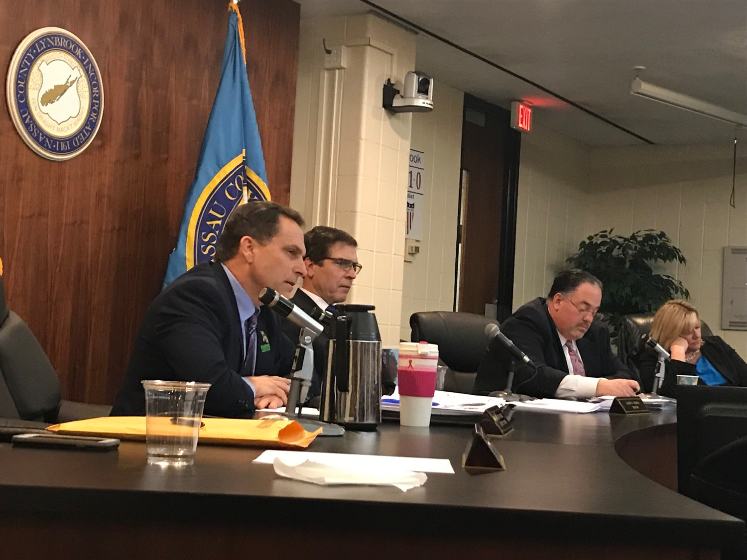 At Monday's village board meeting, Deputy Mayor Hilary Becker, far left, was pressed by residents about his reasons for running for mayor and for opposing the Cornerstone at Lynbrook project. He said his intentions are to help the village prosper.