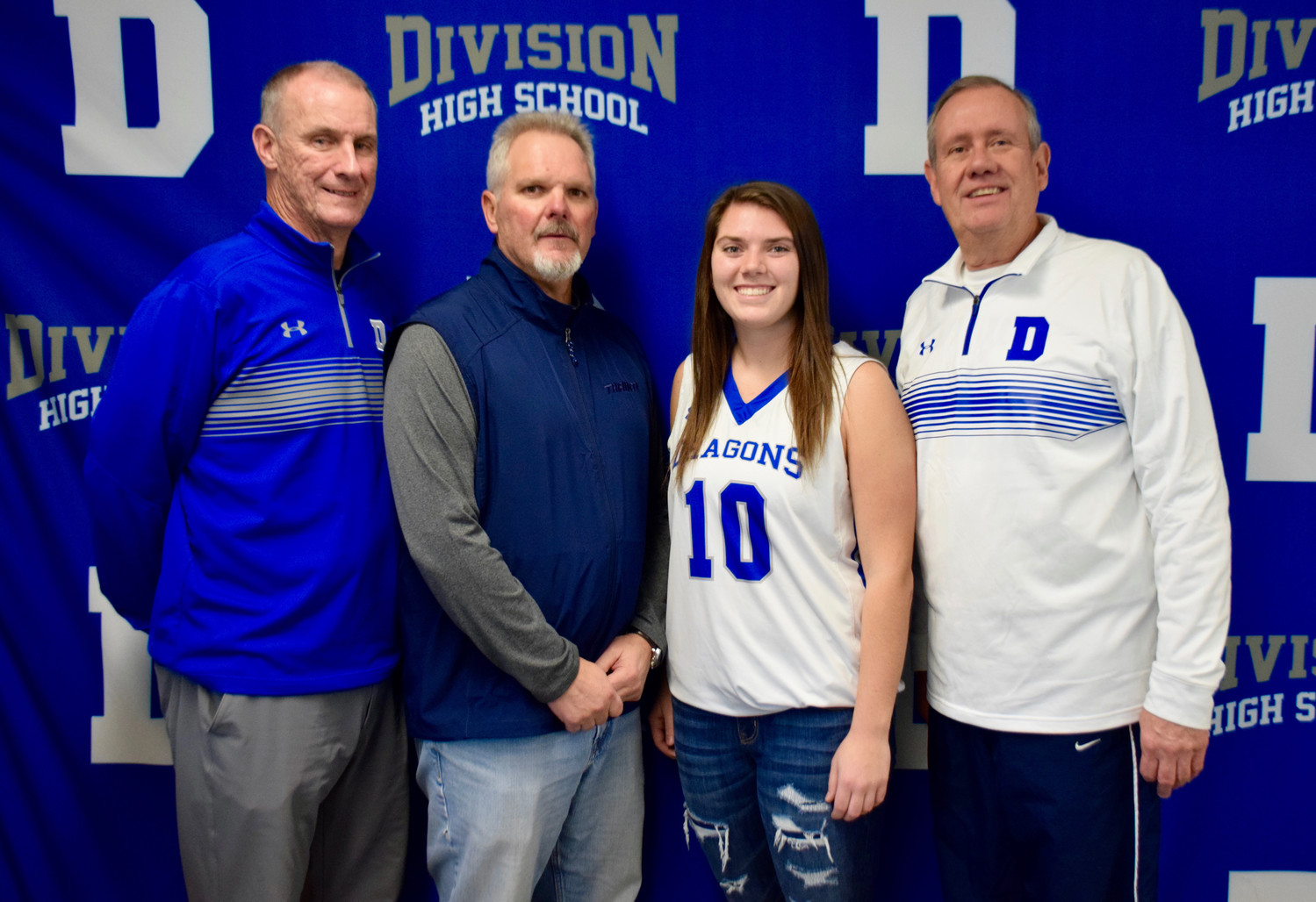 Division Avenue High School senior Madison Gillis with, from left, phys. ed. department chairman Sean Smith, coach Ray Weidlein and coach Steve Kissane. Gillis scored her 1,000th career point on Jan. 5.