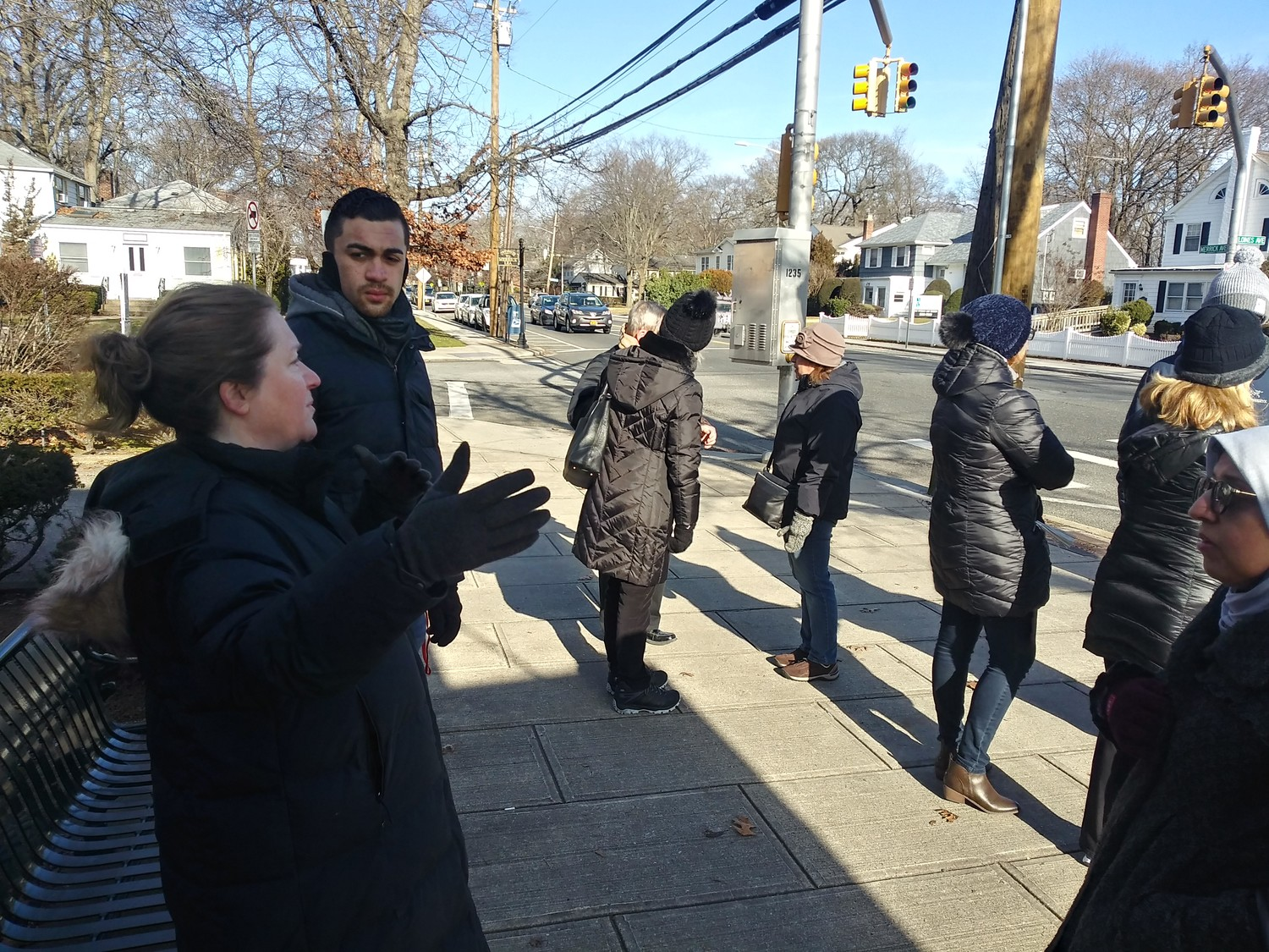 Erin Donohue, at left above, led a walk-through of Merrick Avenue as Nassau County continues its push to reduce the number of lanes on Grand Avenue in Baldwin, which would give it a look similar to Merrick's downtown corridor.