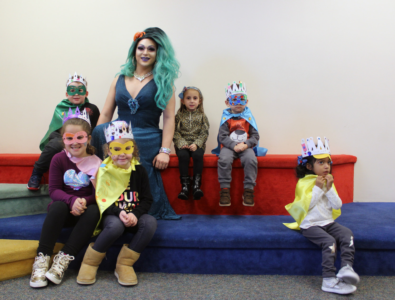 After reading several books about tolerance and inclusivity, Noche complimented children as they created their own crowns and superhero capes and masks. From left were Aiden O'Callaghan, 5, Angelina and Viviana Frisch, 6 and 4, Olivia Longo, 4, Xazar Karimou, 4, and Leilani Grant, 3, all of East Meadow.