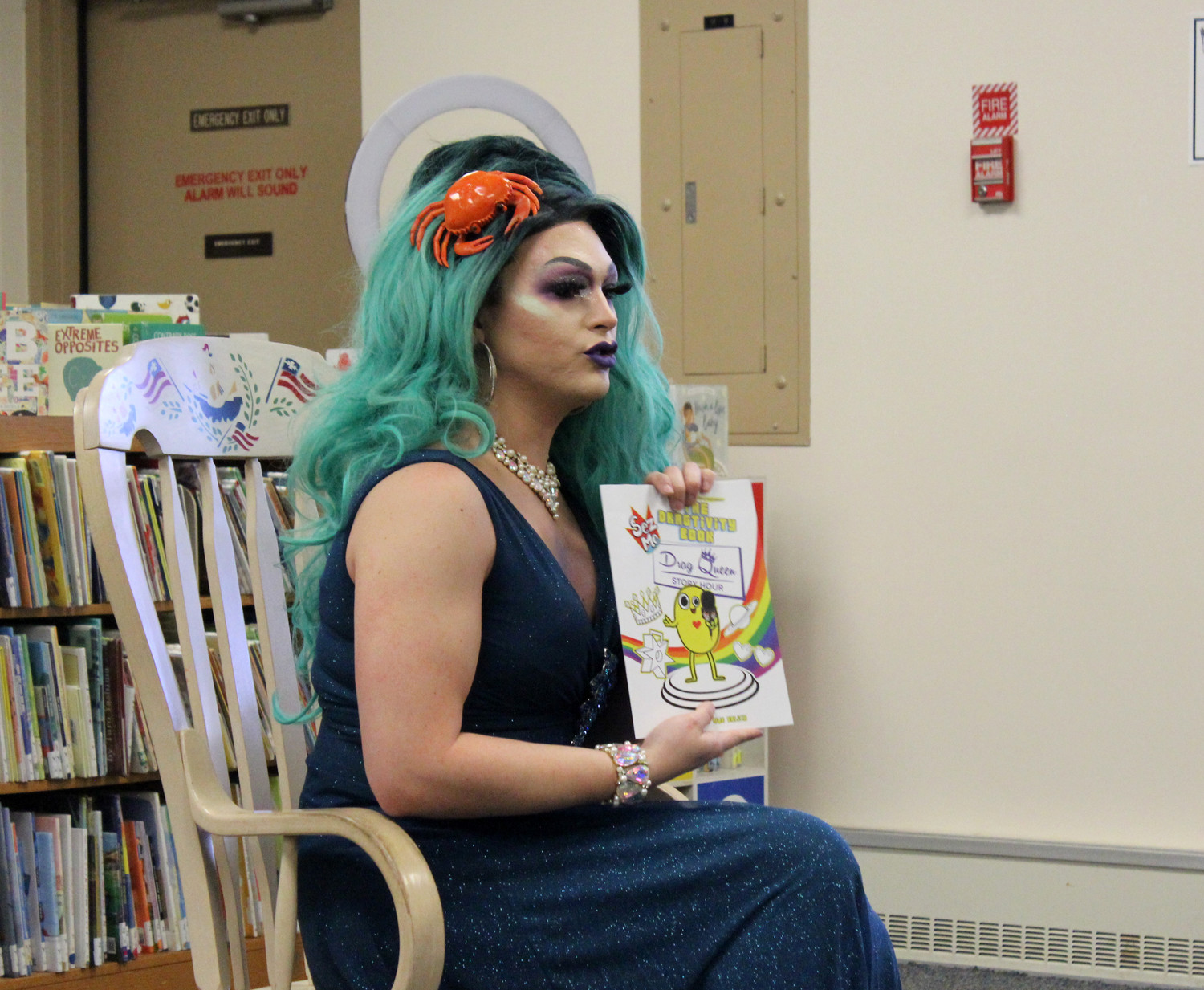 "Noche flipped through ""The Dragtivity Book,"" a coloring book meant to teach children about gender nonconformity, she said."