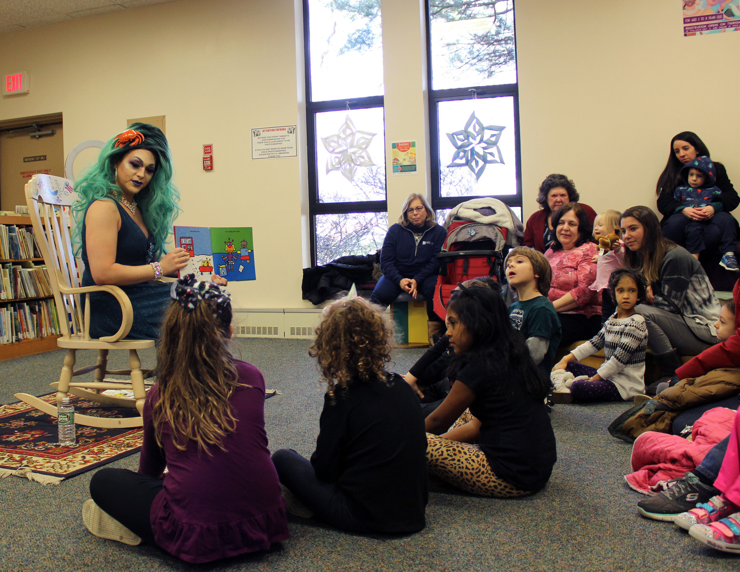 "Bella Noche read several books at Drag Queen Story Hour at the East Meadow Public Library on Jan. 12, including ""Love the World,"" about loving the environment, others and oneself. ""Does everyone here love themselves?"" she asked before starting the book. ""It's important to love yourself."""