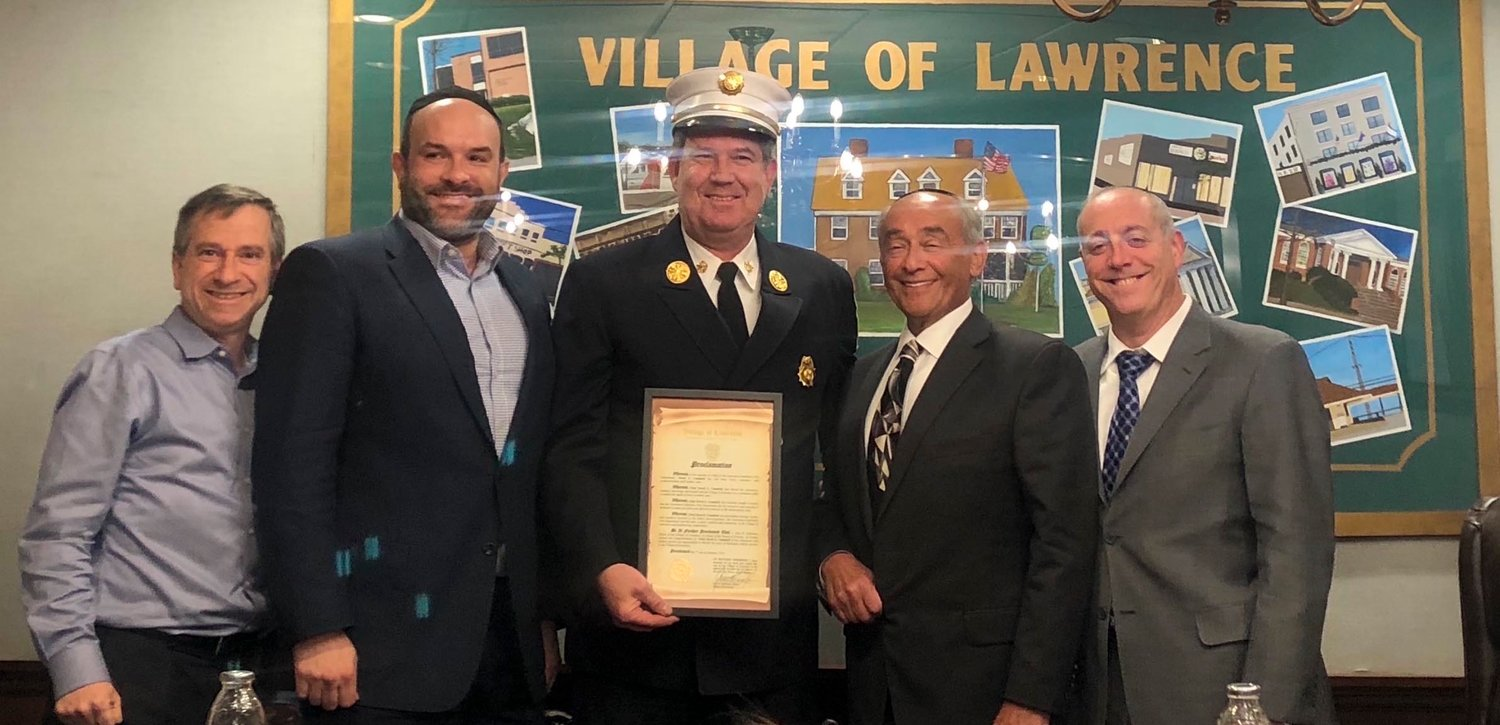 Lawrence village honored outgoing Lawrence-Cedarhurst Fire Department Chief David Campbell at its Jan. 7 meeting. From left Trustee Uri Kaufman, Deputy Mayor Michael Fragin, Campbell, Mayor Alex Edelman and Trustee Daniel Goldstein.