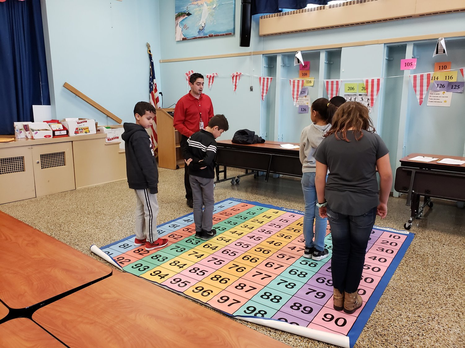 Fourth-grade teacher George DiGiovanni called out numbers for the students to add up to 100 during the adding and subtracting portion of Math Mats.