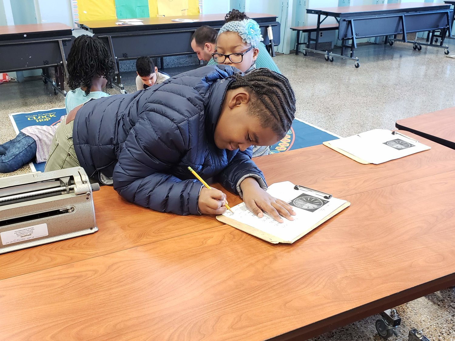 Nine-year-old Kweli Warren hard at work.