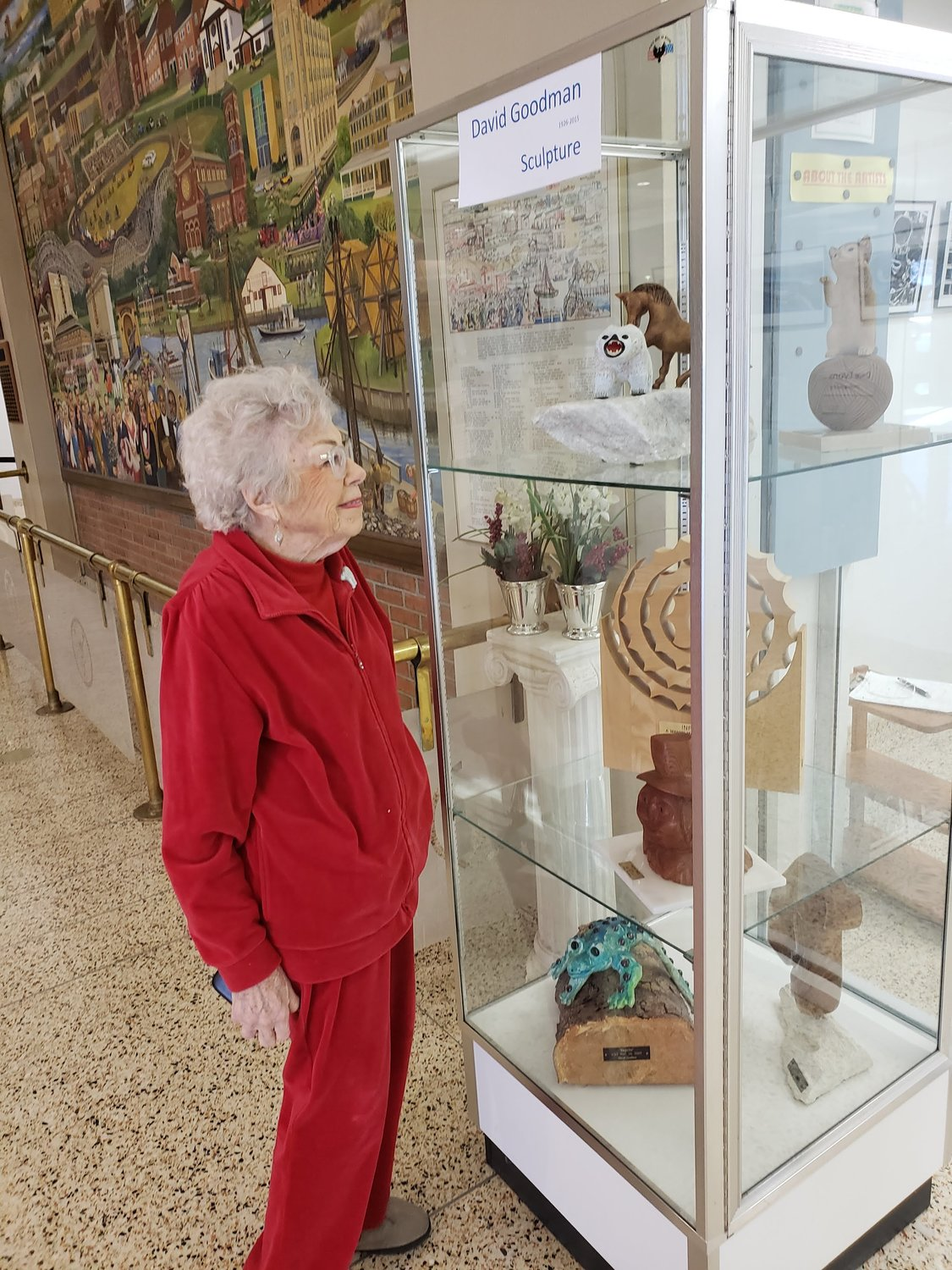 Merrick resident and wife of the late David Goodman, Blanche, admired her husband's wooden sculptures at the Freeport Recreation Center on Jan. 15.