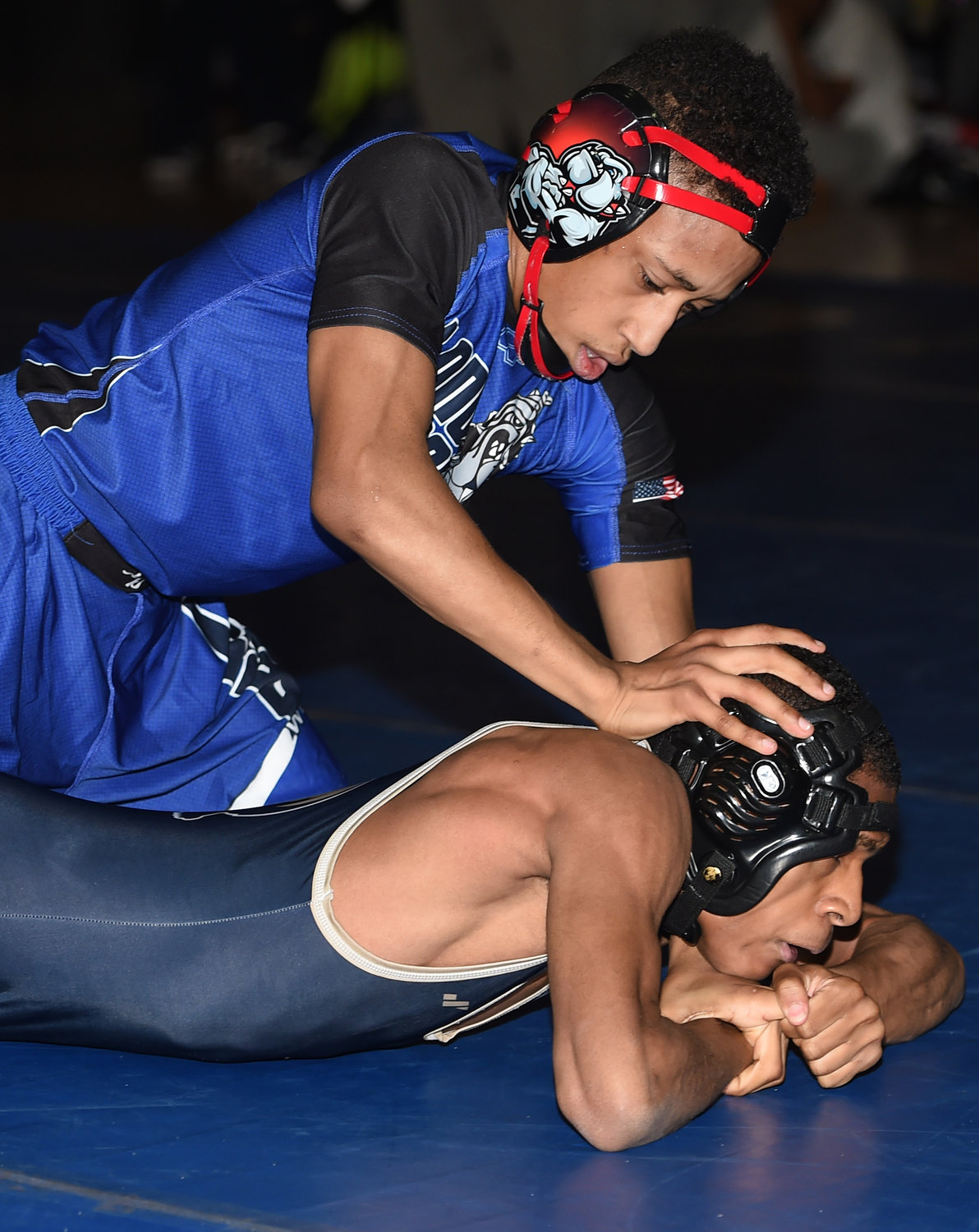 Sophomore Kevin Lopez, top, got Long Beach's conference-clinching win over Baldwin on Jan. 9 started with a pin of Krishawn Rose at 99 pounds.